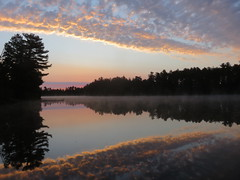Opening up to a summer sunrise.  Explored. (yooperann) Tags: pink sky lake clouds sunrise reflections bass michigan symmetry upper peninsula marquette gwinn