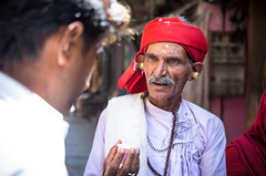 Chai and a chat in Varanasi (phil.w) Tags: street old city travel red portrait india photography gold chat pentax candid varanasi earrings turban mustache limited chai speaking dapper rajasthani smcpfa31mmf18