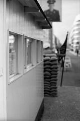 Checkpoint Charlie (Tiefengeist) Tags: 50mm rodinal nikonfe ilford fp4 1100 125 oneshot agfarodinal ilfordfp4125 r09 ais50mmf12 rodinalr09oneshot1100