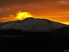 Hiding a sunset (John B G catching up :- )) Tags: winter sunset cloud mountain snow scotland carronvalley meiklebin kilsythhills fujifilmfinepixs100fs marilynclass