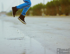 قفزه (Ahmad Al-Hamli) Tags: canon photography 85mm levitation f 18 تصوير ماء شارع رجال مطر ولد معالجة شجر وناسه فله كانون فرحه تجميد تمطر عزل برودكاست نقزه