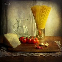 Still life with spaghetti and tomatoes (MargoLuc) Tags: stilllife texture silverware tomatoes jug spaghetti chilli pomodori parmigianoreggiano peperoncino motat clovesofgarlic platinumheartaward tatot stillexcellence