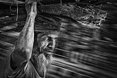 Streets of Dhaka : A lonesome passerby (Shutterfreak ☮) Tags: street old man monochrome walking eyes woods nikon walk beards move pan dhaka nikkor wrinkles rag bangladesh d5000 35mmf18g inkiad