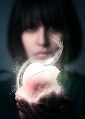 The Apple of Today (iFlook) Tags: portrait apple wisconsin female photoshop logo model nikon post sparkle madison glowing editing manualfocus sparkling londa d5000 holdinganapple manualmeter iflook 105mmnikkorp