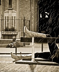 On the streets of Paris (Terry Yarrow) Tags: life street paris rain contrast bench movement relaxing beggar chilling affluence wealth