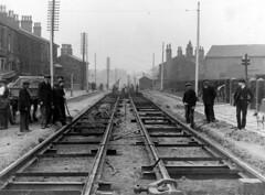 B03591 Tramway track (BuryArchives) Tags: dog men track tram powerlines tramway spade