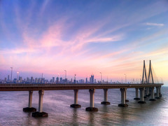 Bombay Skyline (Menetnashté) Tags: bridge sunset sea india west skyline fort gandhi link mumbai bandra rajiv