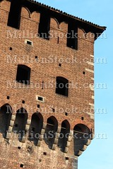 Castle battlements (alessandro0770) Tags: old windows red italy milan building tower castle history tourism rock stone wall architecture vintage religious grate ancient europe italia arch fort antique decorative milano grunge bricks gothic decoration ruin landmark medieval double structure historic frame historical strong mystical aged ornate fortification bastion defensive fortress sforzesco defense bohemian battlements antiquities lancet fortified mullioned