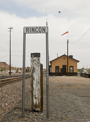 Rincon Depot (jolee-mer) Tags: old railroad sky newmexico bird sign truck day cloudy flag tracks windy depot lonely telephonepoles railyard rincon joleemer