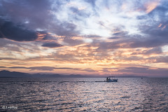 Sailing on the colour table (t.valilas) Tags: sunset sea sky colour clouds landscape boats outdoor greece fishingboats artaki evia euboia euboea neaartaki newartaki