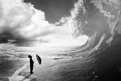 Oh Boy... (Petricor Photography) Tags: sea people blackandwhite white black art rain composition umbrella person waves fine surfing antigua caribbean scenics 2010 composed lineups canonpersonalconnection