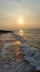 Golden light- kent (Missnadined) Tags: tankerton kent beach sunset golden shimmer pebbles waves