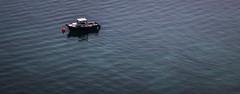 Alone ~ Explored (Matthew Johnson1) Tags: blue sea wales boat alone explore expanse northwales morfanefyn explored