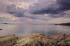 Three Rocks (A. Shamandour) Tags: new city sunset england storm motion color building water boston clouds speed sunrise boats lights cityscape slow massachusetts syria scape damascus towards shutterspeed waterscape