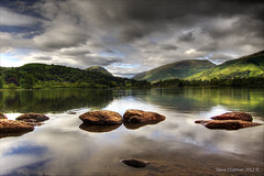 Grasmere (Steve _ C) Tags: lake mountains water rock clouds reflections landscape rocks grasmere lakedistrict filters 1022mm 2011 50d