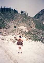 Ovais Adhia at Lake Saif-ul-Mulk (Year 1989) (Ameer Hamza) Tags: pakistan boy snow cold smiling young solo single shorts 1989 northern decor 1990 ovais adhia fototrove ameerhamzacollection hanifadhiacollection
