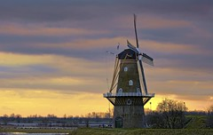 Windmill at the riverside (Wim K) Tags: sky holland color netherlands windmill dutch river photography photo mood stock nederland atmosphere rhine rijn stockphoto waal stockphotography wpk wpk2