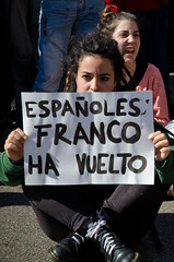 "Protester holding a banner: ""Spaniards, Franco is back."" (Marc Sardon) Tags: students valencia education police institute arrests minors uip lluisvives antiriotpolice publiccuts ieslluisvives"