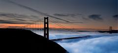 Sunrise over San Francisco and the Golden Gate (danielpivnick) Tags: sanfrancisco california panorama color silhouette fog clouds sunrise bay darkness marin horizon officebuildings goldengatebridge highrise bayarea headlands ggbridge suspensionbridge marinheadlands