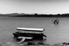 Serenity... (VinothChandar) Tags: india mountain water monochrome canon river photography boat photo long exposure photos pics picture calm perch layer serene karnataka tranquil kabini calmness birdblackwhite