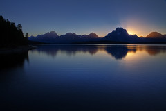 "Jackson Lake sunset - Teton Range (IronRodArt - Royce Bair (""Star Shooter"")) Tags: park blue sunset mountain lake reflection water twilight peak grand jackson mount sunburst rays grandtetons moran range grandtetonnationalpark jacksonlake"