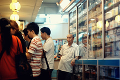 Busy Evening Crowd (Jon Siegel) Tags: people man shop standing nikon singapore waiting chinatown f14 85mm pharmacy busy elderly nikkor tcm chinesemedicine chemist singaporean traditionalchinesemedicine nikkor85mm nikkor85mmf14afd
