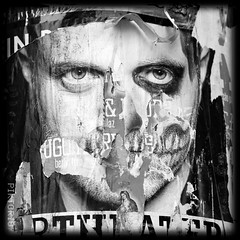 damaged mask (PIKTORIO) Tags: street wallpaper bw man berlin face germany paper poster eyes mask theatre decay ripped makeup torn decollage lacerated maquilage monsterclown piktorio