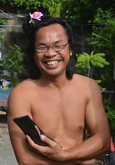 laughing man with plastic hair accessory (the foreign photographer - ) Tags: man laughing portraits hair thailand nikon bangkok plastic lard bang bua accessory khlong bangkhen d3200 phrao