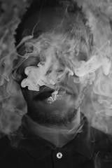 'Smokey' ii. (miranda.valenti12) Tags: portrait blackandwhite black face up weed jay close expression background smoke smoking smokey roll blunt facial rolling peso hundoo