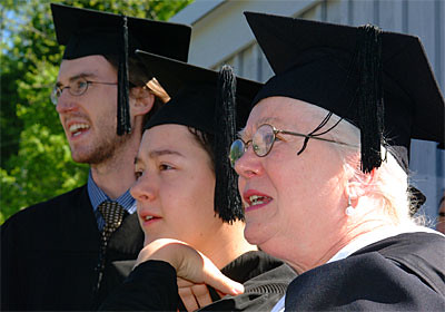 Graduates Gahlord Dewald and Carrie Sterr, and literature professor Geraldine Pittman de Batlle, Watch Preparations
