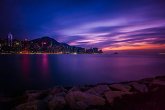 purple velvet sunset (dawvon) Tags: world ocean china city longexposure travel sunset sea sky urban hk cloud seascape nature colors night dark landscape hongkong twilight rocks asia cityscape skyscrapers purple nightshot harbour stones promenade   kowloon     hongkongisland  victoriaharbour                 kowloonwest westkowloonwaterfrontpromenade
