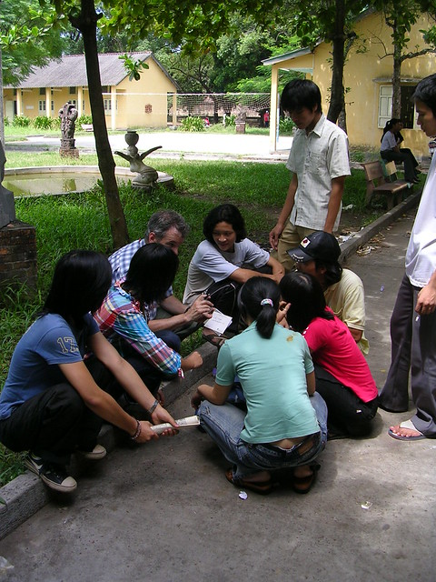 Tim Segar talking with students at an art school in Hue, Central Vietnam