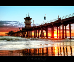 After The Storm (Tony DeSantis Photography) Tags: ocean california ca blue sunset storm reflection bird beach water clouds pier sand surf waves pacific surfer huntington wave surfing orangecounty huntingtonbeach rubys hdr hb bolsachica photomatix explored nikcolorefexpro topazadjust
