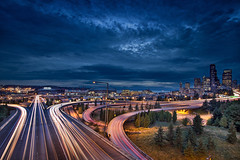 Seattle City Lights and Light Trails at Blue Hour - HDR (David Gn Photography) Tags: seattle city travel blue light tourism skyline modern buildings evening washington office twilight highway cityscape view skyscrapers traffic state dusk stadium scenic trails landmark historic arena hour freeway safeco pugetsound metropolitan hdr condominiums joserizalbridge 3exp canoneos7d sigma1020mmf35exdchsm centurylink