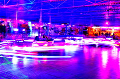 bumper car (redglobe*) Tags: pink blue light people colour bulb night germany licht roundabout carousel timeexposure lux karussell mnster bumpercar carrusel lumen sendmnster