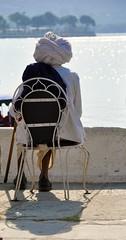 Gazing at Lake Pichola (vishaka jayakumar) Tags: old india lake man chair elderly turban rajasthan udaipur pichola