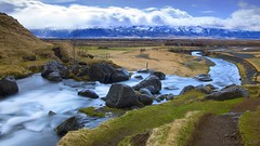A waterfall's attraction for the mountains aka a fall with two names (lunaryuna) Tags: panorama water beauty season landscape volcano waterfall iceland spring ngc glacier lunaryuna cloudscape mountainrange mountainstream southiceland weathermood gluggafosswaterfall seasonalwonders eyjafjallajokullvolcanoandglacier merkjriver