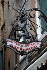 Trattoria al Giardinetto (Crumblin Down) Tags: bridge venice red italy musician music food reflection clock water hat yellow shop mirror canal store italia mask pizza chrome ear gondola stick van gogh venezia gondolier selfie ferro forcola