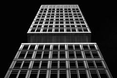 Flying storefront (alxfink) Tags: light blackandwhite bw berlin up facade lumix blackwhite storefront blacksky
