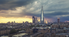 City (Umbreen Hafeez) Tags: city uk blue houses roof light sunset england building london eye tower st skyline architecture night skyscraper buildings dark twilight europe long cityscape cathedral outdoor dusk low pauls hour wharf gb canary shard complex bt