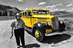 July 2011 - Yellowstone tour bus and driver (lazy_photog) Tags: park old color bus photography tour antique lazy national yellowstone wyoming elliott selective photog worland