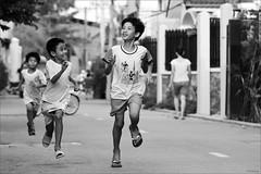 Run to win (-clicking-) Tags: life street blackandwhite bw boys monochrome kids race rural children asian blackwhite asia child innocent streetphotography streetlife run racing vietnam enjoy innocence moment runing nocolors