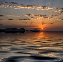 Sunrise Rays (StevieC-Photography) Tags: sea sky cloud sun sunlight seascape reflection nature rock vertical outdoors island photography spain nopeople dramaticsky scenics tranquilscene beautyinnature breakingdawn colourimage steviec sunriserays ibizaisland ibizasunrise