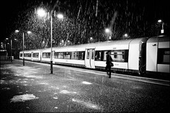 Snowy Journey (Sven Loach) Tags: winter bw snow storm cold london station weather night train walking lights evening nikon platform streetphotography falling passenger february publictransport depth overground tfl highburyislington d5100
