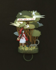 Little Red riding Hood. A paper ring. (Elsita (Elsa Mora)) Tags: trees red woman plants black bird nature girl birds night forest dark paper woods wolf handmade framed oneofakind jewelry ring littleredridinghood onceuponatime fox blogged shadowbox papercut papercutout elsita elsamora