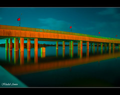 Bridge (Khalid.Amin) Tags: bridge blue pakistan red sky orange reflection water beautiful beauty night canon eos long exposure scene flags karachi soe vag 500d wow1 wow2 wow3 wow4 finegold flickraward heartawards platinumheartaward flickraward5 flickrawardgallery