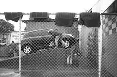 Car Wash (Braden Gunem) Tags: auto man black color men car fence automobile small carwash wash vehicle nicaragua matts washing