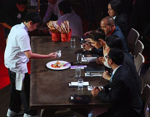 Junior MasterChef Kyle serves his dream dish, Asian fusion shrimp and scallops to the judges
