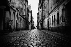 to the end (ewitsoe) Tags: road street city travel blackandwhite bw tourism rain weather 35mm dark alley nikon europe day poland polska overcast polish visit cobblestones raining treatment poznan d80 visitpoznan visitpoland