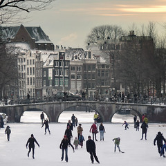 Amsterdam's canals become all-natural ice-skating venues (Bn) Tags: winter people cold holland ice netherlands dutch amsterdam geotagged frozen topf50 downtown iceskating skating joy kinderen nederland freezing first canals age skate anton temperature topf100 mokum occasion rare g